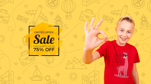 Front view of child smiling and giving thumbs up with sale Free Psd