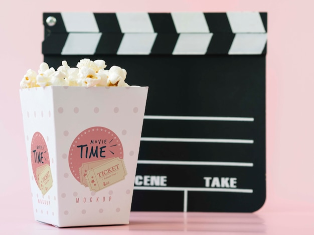 Front view of cinema clapperboard and popcorn Free Psd