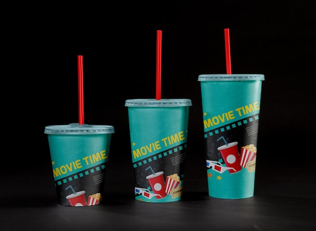 Front view of cinema cups with straws Free Psd
