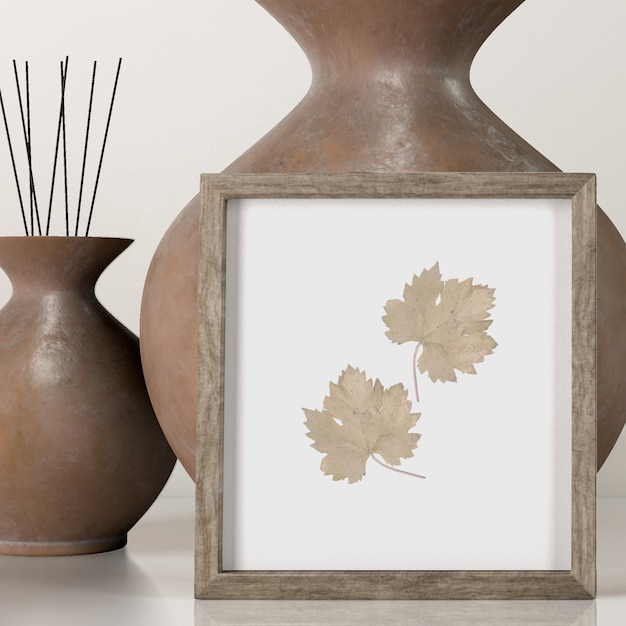 Front view of decorative vases with frame Free Psd