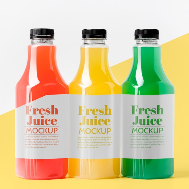 Front view of different glass juice bottles with caps Free Psd