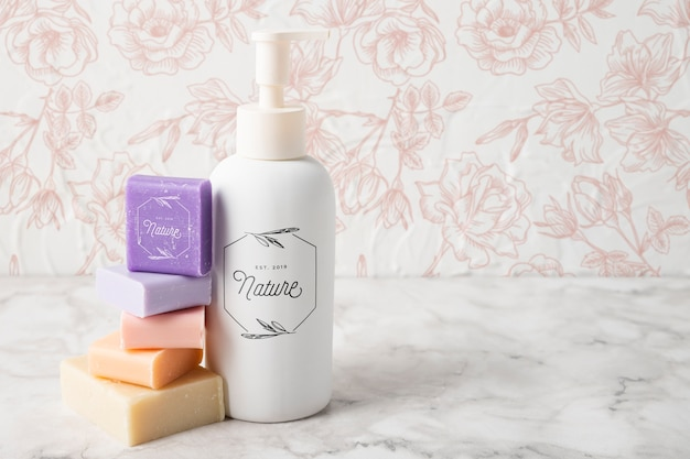 Front view of essential oil and colorful soap Free Psd