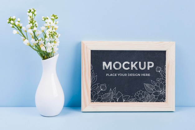 Front view of flowers in vase with frame mock-up Free Psd