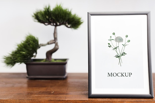 Front view of frame and bonsai for home interior Free Psd