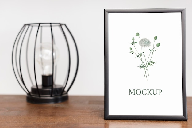 Front view of frame and lamp for home interior Premium Psd
