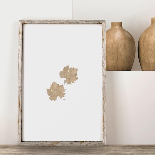 Vista frontale del telaio con foglie e vasi Psd Gratuite