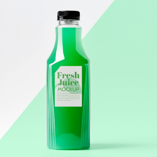 Front view of glass juice bottle with cap Free Psd