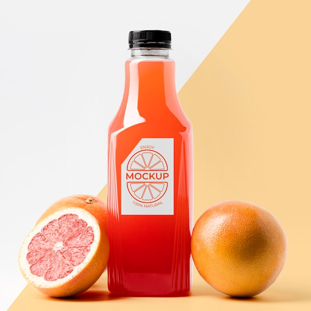 Front view of grapefruit juice bottle with cap Free Psd