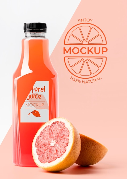 Front view of grapefruit juice glass bottle with cap Free Psd