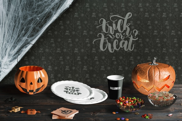 Front view of halloween elements on wooden table Free Psd