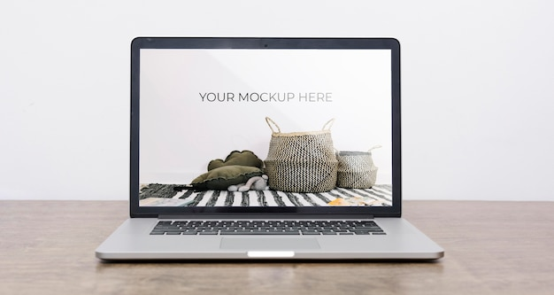 Front view of laptop mock-up for interior decoration Free Psd
