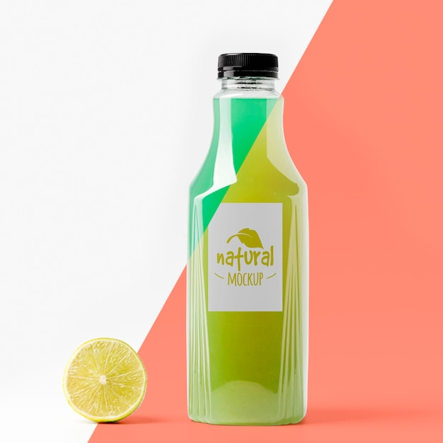 Front view of lemon juice glass bottle Free Psd