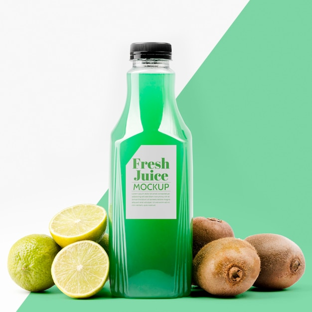 Front view of lemon and kiwi juice bottle Free Psd