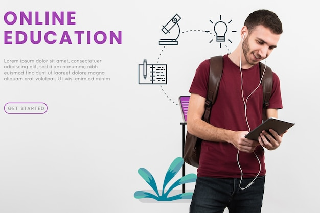 Вид спереди человек студент с планшета Бесплатные Psd
