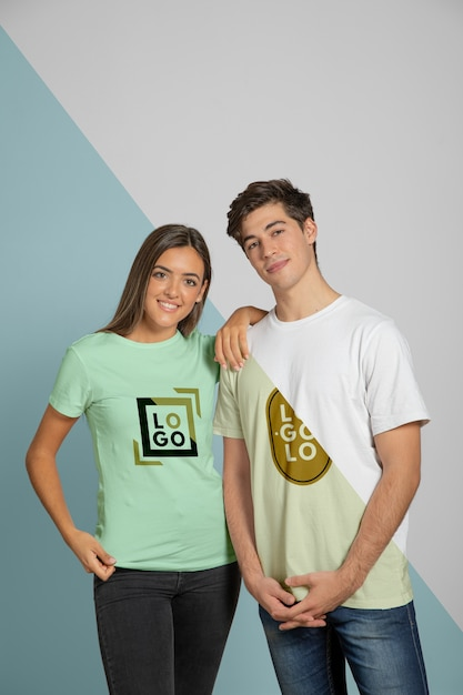 Front view of man and woman posing in t-shirts Free Psd