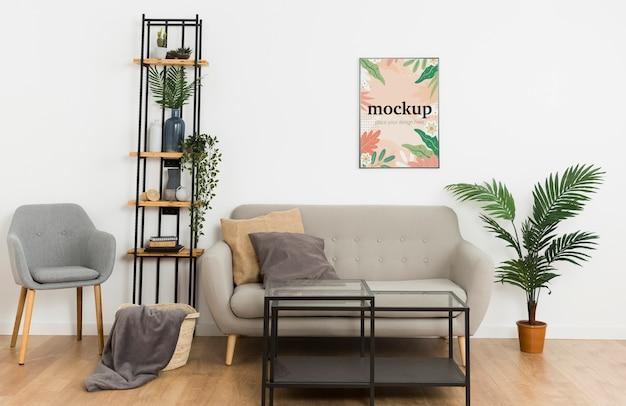 Рамка макета вид спереди на белой стене в гостиной Premium Psd