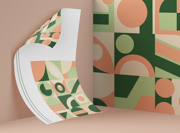 Front view of mock-up paper with multicolored geometric shapes Free Psd
