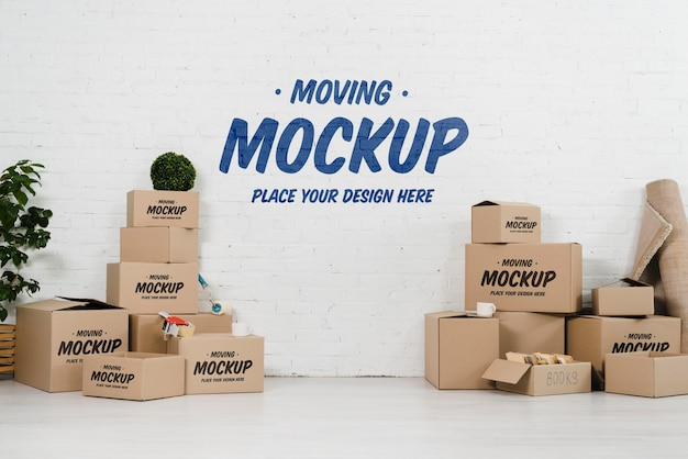Vista frontale del mock-up di scatole in movimento Psd Gratuite