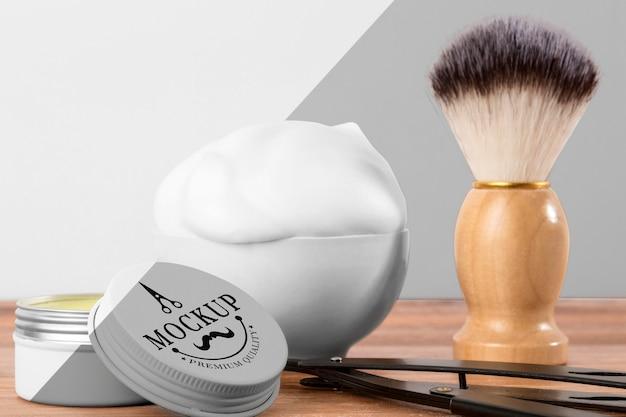 Вид спереди продуктов для парикмахерских с кистью и пеной Бесплатные Psd