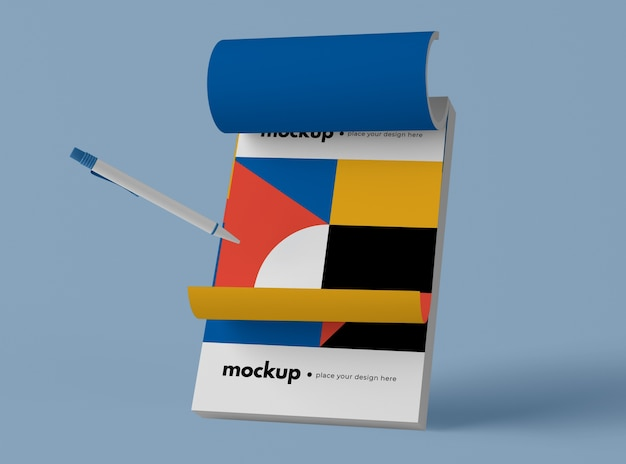 Front view of pen and notepad with geometric shapes Free Psd