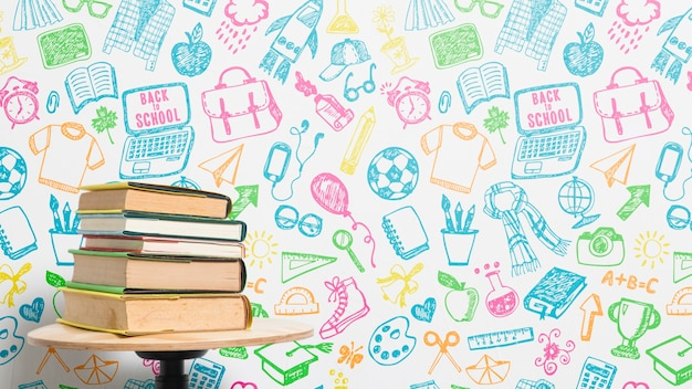 Front view pile of books with colourful background Free Psd