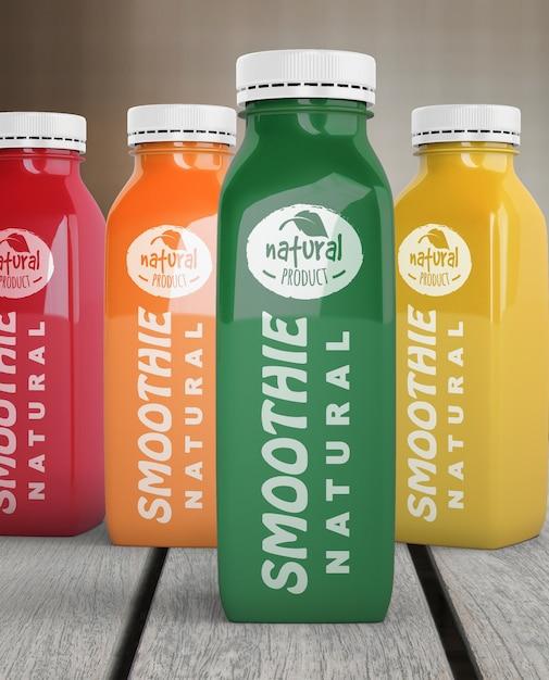 Вид спереди пластиковых бутылок с различными фруктовыми или овощными соками Бесплатные Psd