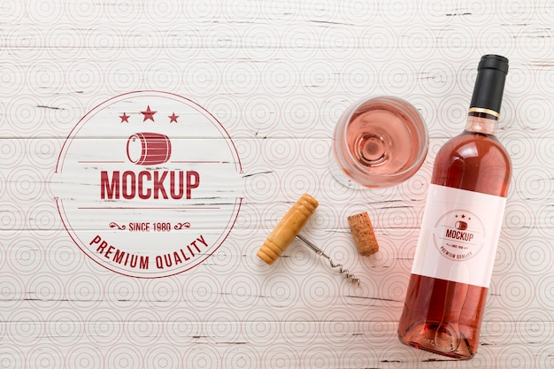 Front view rose wine bottle and glass Free Psd
