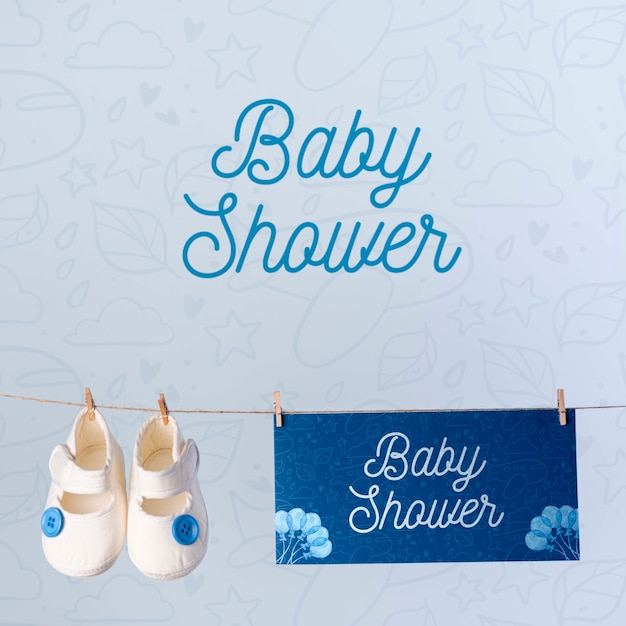 Front view of shoes with blue baby shower decoration Free Psd