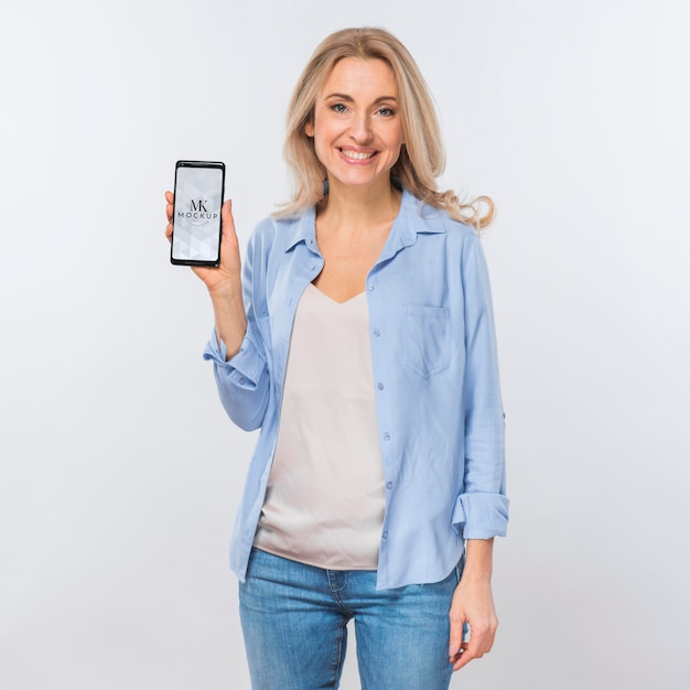 Front view of smiley woman holding smartphone Free Psd