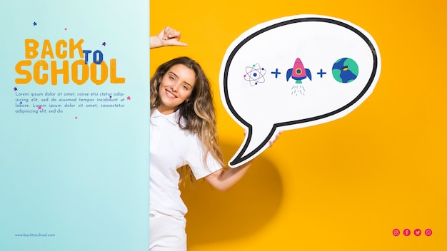 Front view smiling teenager girl holding speech bubble Free Psd