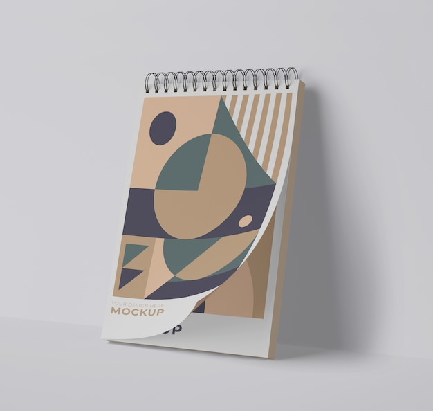 Front view of spiral notebook with geometric shapes Free Psd