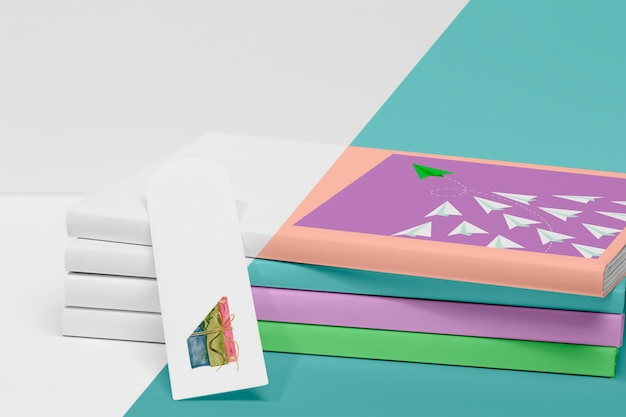 Front view stack of books mock-up with bookmark Free Psd