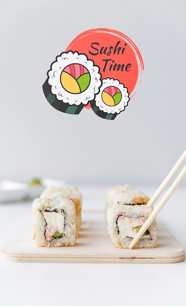 Front view of sushi on chopper with chopsticks Free Psd