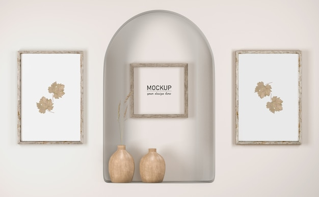 Vista frontale della parete con cornice decor e vasi Psd Gratuite