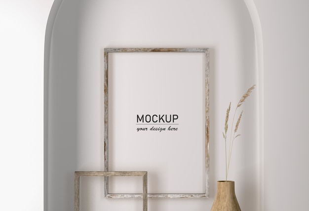 Front view of wall with frames decoration and vase with flower Premium Psd