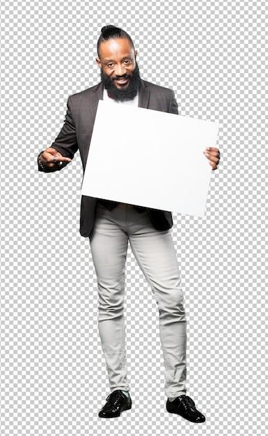 Full body black man holding a blank placard Premium Psd