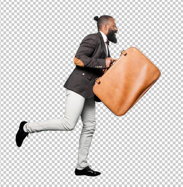 Full body black man holding a leather bag Premium Psd