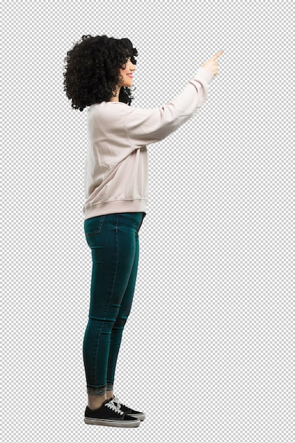 Full body young woman pointing aside Premium Psd