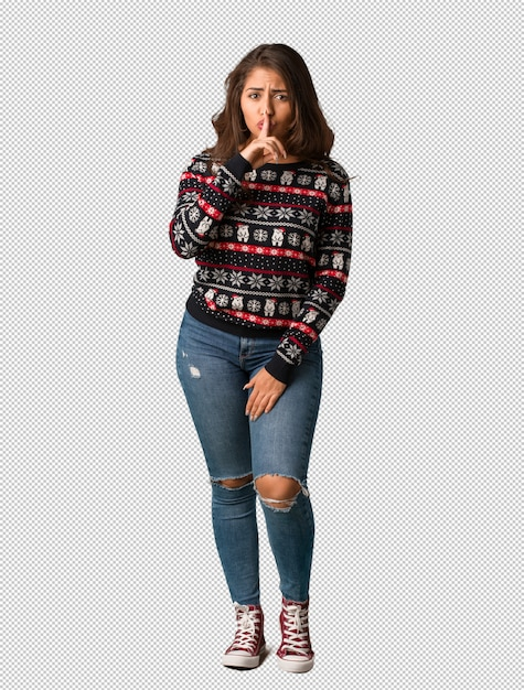 Full body young woman wearing a christmas jersey keeping a secret or asking for silence Premium Psd