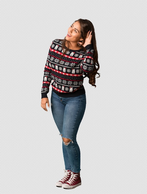 Full body young woman wearing a christmas jersey try to listening a gossip Premium Psd
