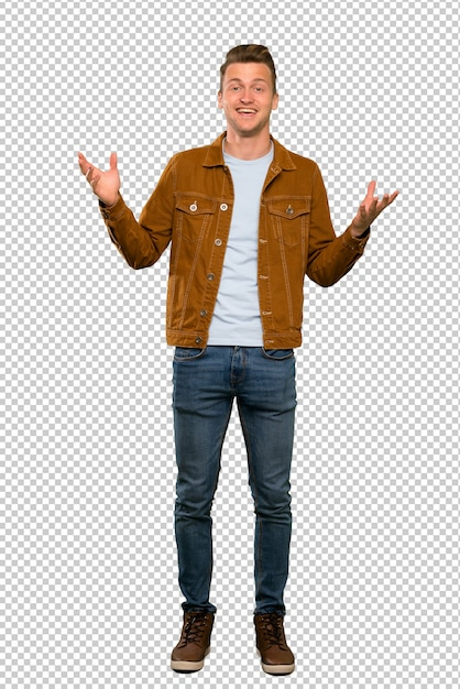 A full length shot of a blonde handsome man smiling a lot Premium Psd