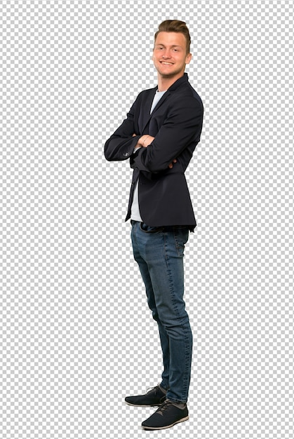 A full length shot of a blonde handsome man with arms crossed and looking forward Premium Psd