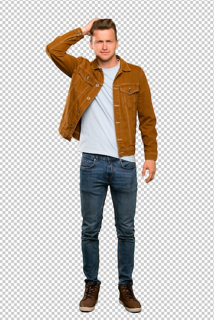 A full length shot of a blonde handsome man with an expression of frustration and not understanding Premium Psd
