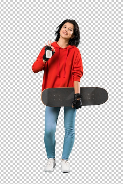 A full length shot of a young skater woman showing ok sign with fingers Premium Psd