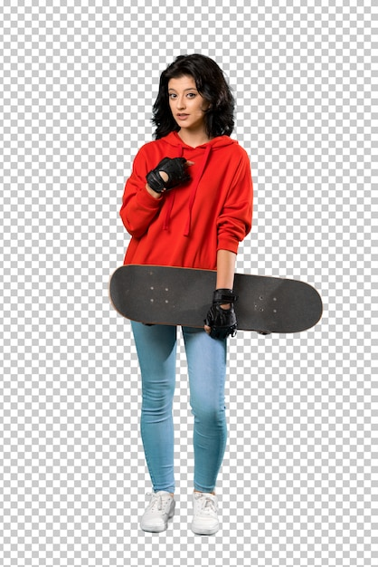 A full length shot of a young skater woman with surprise facial expression Premium Psd