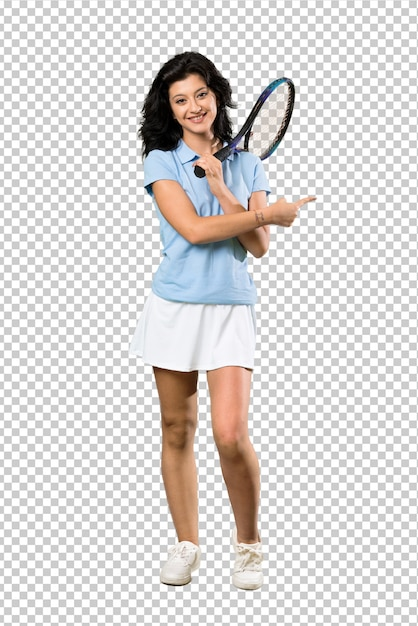 A full length shot of a young tennis player woman pointing to the side to present a product Premium Psd