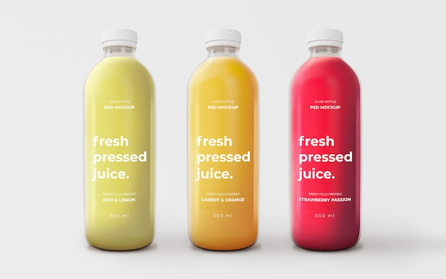 Fully editable mockup with glass bottles of different flavours Free Psd