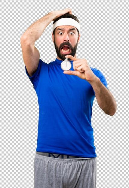 Funny sportsman holding vintage chronometer Premium Psd