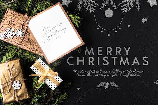 Gifts for christmas with card beside Free Psd