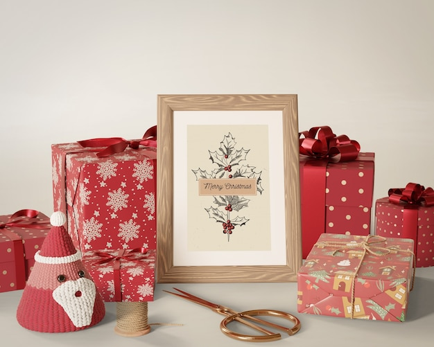 Gifts wrapped placed beside painting Free Psd